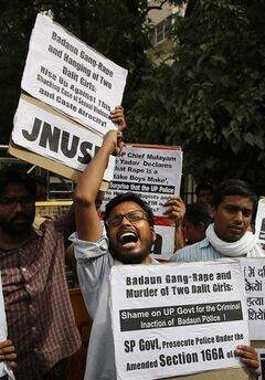 Members of Jawaharlal Nehru University Students Union shout slogans during a protest against a gang rape of two teenage girls in Katra village, outside the Uttar Pradesh state house, in New Delhi, India, Friday, May 30, 2014. A top government official said the northern Uttar Pradesh state has sacked two police officers who failed to respond to a complaint by the father of the two teenage girls who went missing and were later found gang raped and killed. (AP Photo/Manish Swarup)