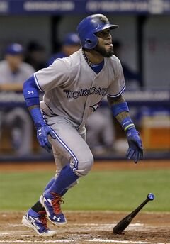 Toronto Blue Jays' Jose Reyes follows the flight of his three-run home run off Tampa Bay Rays starting pitcher Jeremy Hellickson during the fourth inning of a baseball game Tuesday, Sept. 2, 2014, in St. Petersburg, Fla. (AP Photo/Chris O'Meara)