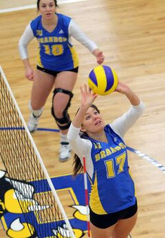 Larissa Vonkeman of the Brandon University Bobcats sets the ball against the University of Manitoba Bisons at the Healthy Living Centre on Saturday evening.