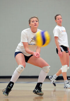 Fifth-year middle Lexi Loewen looks to pass the ball in practice on Thursday.