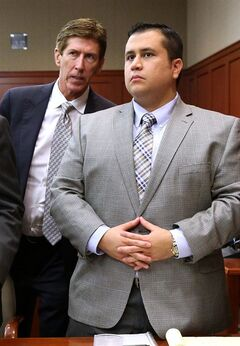 FILE - In this June 17, 2013, file photo, defense attorney Mark O'Mara, left, talks to defendant George Zimmerman during a recess in Zimmerman's trial in Seminole circuit court in Sanford, Fla. Part of a lawsuit against NBC Universal that claims that the television network defamed Zimmerman in a 2012 broadcast was thrown out by a Florida judge Thursday, June 19, 2014, putting the entire litigation in jeopardy. (AP Photo/Orlando Sentinel, Joe Burbank, Pool, File)