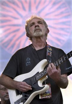 FILE - In this June 5, 2004 file photo, singer-songwriter J.J. Cale plays during the Eric Clapton Crossroads Guitar Festival in Dallas, Texas. Cale's best-known songs became hits for Eric Clapton with