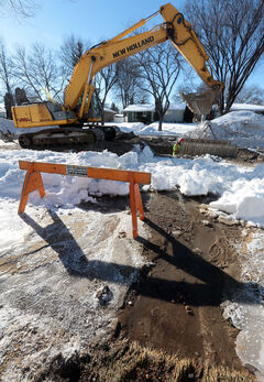 City crews work to repair a water main break on Silverbirch Drive earlier this year. Below normal temperatures have kept city work crews busy with water main breaks throughout the city.