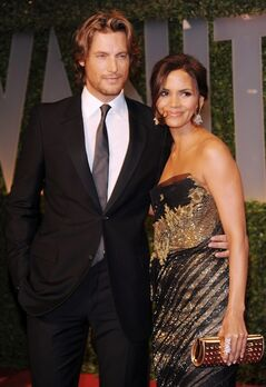 FILE - In this Feb. 22, 2009 file photo, actress Halle Berry, right, and Gabriel Aubry arrive at the Vanity Fair Oscar party in West Hollywood, Calif. A judge approved a partial child support settlement on Friday, May 30, 2014, that requires Berry to pay her ex-boyfriend $16,000 a month, or nearly $200,000 a year, to support their 6-year-old daughter. The former couple had been involved in a custody dispute in 2012. (AP Photo/Evan Agostini, file)
