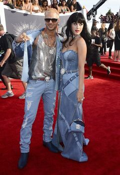 Riff Raff, left, and Katy Perry arrive at the MTV Video Music Awards at The Forum on Sunday, Aug. 24, 2014, in Inglewood, Calif. Katy Perry and Riff Raff were feeling the blues as they made a splash on the red carpet at the VMAs in their all-denim ensembles. The duo channelled matching styles worn by Britney Spears and Justin Timberlake more than a decade ago. THE CANADIAN PRESS/ Invision/AP, Jordan Strauss