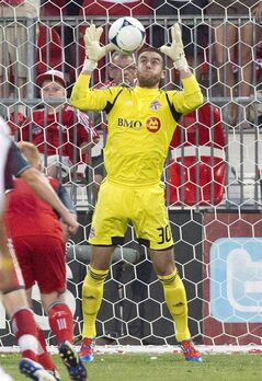 Toronto FC goalkeeper Milos Kocic makes a save against the Colorado Rapids in Toronto on July 18, 2012. Kocic, who spent three seasons with Toronto FC, is back in town looking to show off his goalkeeping skills. THE CANADIAN PRESS/Fred Thornhill