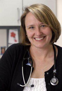 In this Monday, Feb. 25, 2013 photo, Dr. Rebecca Johnson, a cancer specialist at Seattle Children's Hospital, poses in her office in Seattle. Johnson is the lead author of a new study that shows that advanced breast cancer cases have increased slightly among young women, a 34-year analysis suggests, raising many questions about possible reasons even as the disease remains uncommon in women younger than 40. Johnson herself was diagnosed with early-stage breast cancer at age 27, 17 years ago. Unlike women in the study, Johnson's cancer was caught early. (AP Photo/Elaine Thompson)