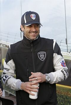 FILe - In this Jan. 25, 2014 file photo, Patrick Dempsey laughs with other drivers in the Fanzone area during an autograph session prior to the start of the IMSA Series Rolex 24 hour auto race at Daytona International Speedway in Daytona Beach, Fla. Dempsey's love affair with sports-car racing was always more than a frivolous dalliance. He's as dedicated on the track as he is on the set, and placed his sights _ from the eyes of one of People magazine's sexiest men alive _ on contending in the most prestigious road race on the sports car circuit. (AP Photo/John Raoux, File)
