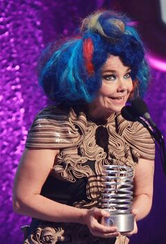 FILE - In this May 21, 2012 file image originally released by Starpix, musician Bjork holds her award at the16th Annual Webby Awards at the Hammerstein Ballroom in New York. Bjork will be getting her own multimedia retrospective at the Museum of Modern Art in New York next year. The museum will draw on sound, film, visuals, instruments, costumes and performance to chronicle the Icelandic singer's 20-plus years as an imaginative and colorful solo artist. The retrospective is being organized by Klaus Biesenbach, MoMA's chief curator at large, and runs March 7-June 7 in 2015. (AP Photo/Starpix, Dave Allocca, File)