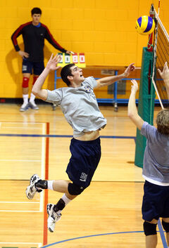 Dan Boutwell of the BU men's volleyball team leaps for a spike in practice Tuesday.
