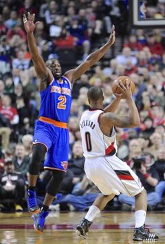 New York Knicks' Raymond Felton (2) defends against Portland Trail Blazers' Damian Lillard (0) during the first half of an NBA basketball game in Portland, Ore., Thursday, March 14, 2013. (AP Photo/Greg Wahl-Stephens)