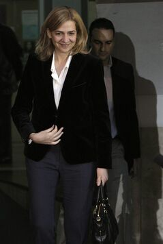 FILE - In this Feb. 8, 2014 file photo, Spain's Princess Cristina leaves the courthouse of Palma de Mallorca in Palma Mallorca, Spain after being named as a fraud and money laundering suspect. A Spanish judge on Wednesday June 25, 2014, has moved closer to indicting Princess Cristina, sister of newly proclaimed King Felipe, in a tax fraud and money laundering investigation centering on her husband. Wrapping up a four-year pre-trial investigation, Palma de Mallorca investigative magistrate Jose Castro kept Cristina on the list of suspects he thinks should stand trial, in her case for money laundering and tax fraud cooperation. (AP Photo/Manu Mielniezuk, File)
