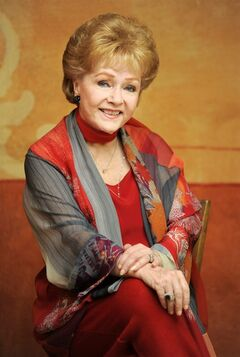 FILE - In this May 21, 2013 file photo, actress Debbie Reynolds poses for a portrait in Beverly Hills, Calif. Reynolds will be honored with the 2014 SAG Lifetime Achievement Award During the Screen Actors Guild Awards ceremony on Sunday, Jan. 25, 2015. (Photo by Chris Pizzello/Invision/AP, File)