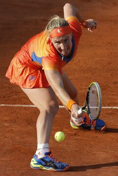 Russia's Svetlana Kuznetsova returns the ball to Lucie Safarova of the Czech Republic during their fourth round match of the French Open tennis tournament at the Roland Garros stadium, in Paris, France, Monday, June 2, 2014. (AP Photo/Michel Spingler)