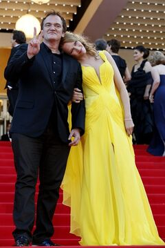 Director Quentin Tarantino, left, and actress Uma Thurman arrive for the screening of Sils Maria at the 67th international film festival, Cannes, southern France, Friday, May 23, 2014. (AP Photo/Alastair Grant)