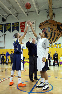Legendary former Brandon men's basketball coach Jerry Hemmings throws the ball for a ceremonial tip-off at Saturday's game between the Bobcats and Lethbridge Pronghorns, marking the last games for the BU basketball teams in the gymnasium. Next season they play in the new Healthy Living Centre.