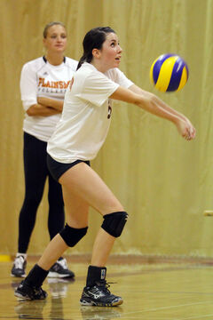 Crocus coach Trista Wenger watches Abbi Robinson pass the ball during the Top 8 Debate tournament Friday.