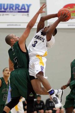 Kenonte Ramsey (3) of the Brandon Bobcats drives at defender James York of Fraser Valley on Friday night.