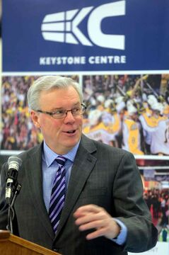 Premier Greg Selinger comments about the roof leaking on his forehead the last time he was in the Keystone Centre's City Square Arena during a funding announcement to replace the roof on the building on Thursday.