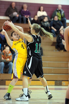 Neelin's Kristine Ward pressures Crocus Plains' Mia Flamand Tuesday.