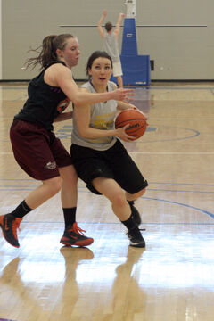 Virden's Natalie Vachon tries to drive past Logan Biccum on Thursday at BU.