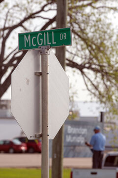 "Ed McGill is also commemorated with a road named after him at the airport. Other roads at the airport include Commonwealth Way (where the Commonwealth Air Training Plan Museum is) and Aviation Avenue, along with Agnew Drive, named after Wes Agnew, a Hartney-area farmer and airplane collector who helped kickstart the museum. Sandison Road, on which the airport itself is located, is named after John William Sandison, a farmer in the late 1800s whose nickname was the ""Wheat King."" His former home is just west of the airport."