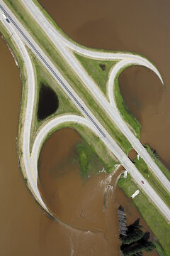 Grand Valley Road and the on/off ramps to the Trans Canada Highway west of Brandon sit under floodwaters from the rising Assiniboine River on Saturday as seen from one of the Brandon Flying Club's Cessna 172 planes.