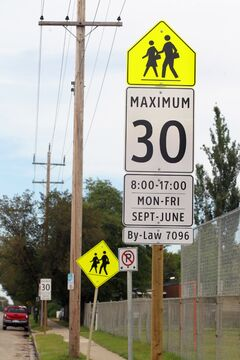 29082014 New signage marking the speed limit changes in school zones is posted on 26th Street near J.R. Reid School in Brandon.