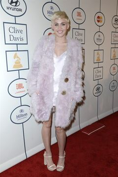 Miley Cyrus arrives at the 56th annual GRAMMY awards - salute to industry icons with Clive Davis, on Saturday, Jan. 25, 2014, in Beverly Hills, Calif. (Photo by Dan Steinberg/Invision/AP)
