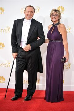 Kevin Spacey, left, and Ashleigh Banfield arrive at the 66th Annual Primetime Emmy Awards at the Nokia Theatre L.A. Live on Monday, Aug. 25, 2014, in Los Angeles. (Photo by Richard Shotwell/Invision/AP)