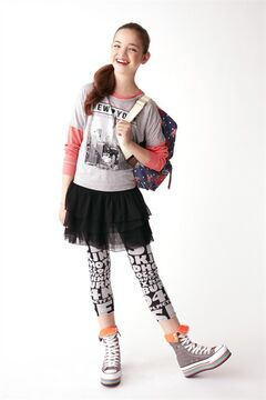 A model is seen wearing a graphic T-shirt ($12.99), a long-sleeve shirt ($14.99), a tiered skirt ($14.99), printed leggings ($7.99) high-top sneakers ($39.99) and a backpack ($25.99) from Winners in this undated handout photo.THE CANADIAN PRESS/HO-Winners
