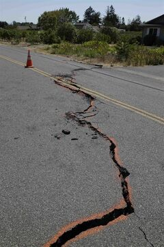 FILE - In this Aug. 24, 2014 file photo, a cracked section of roadway is shown in the Carneros district of Napa, Calif., following an earthquake. Emerging data on last month's Northern California earthquake is explaining why the city of Napa suffered so much of the damage. (AP Photo/Eric Risberg, File)