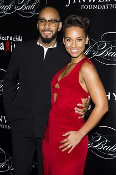 FILE - In this Thursday, Nov. 7, 2013, file photo, Swizz Beatz and Alicia Keys attend Keep a Child Alive's 10th Annual Black Ball in New York. Keys is pregnant with her second child, making the announcement on Thursday, July 31, 2014, which also marks her fourth wedding anniversary to Beatz. (Photo by Charles Sykes/Invision/AP, File)