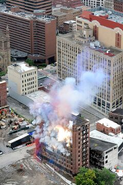Explosives are set off inside the Wellington Annex during an implosion on Saturday, Aug. 23, 2014, in Albany, N.Y. The building was imploded to make way for Albany's new convention center. (AP Photo/Times Union, Cindy Schultz)
