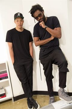 In this Thursday, May 22, 2014 photo, Dao-Yi Chow, left, and Maxwell Osborne, the designers behind Public School, pose for a portrait in their New York fashion studio. (AP Photo/Mark Lennihan)