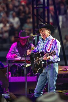 George Strait performs during his farewell tour at AT&T Stadium in Arlington, Texas, Saturday, June 7, 2014. About 105,000 people packed in for the last concert of Strait's final tour —exceeding the stadium's official capacity by 5,000— and shattering the previous record set by The Rolling Stones at The Louisiana Superdome in 1981. (AP Photo/The Fort Worth Star-Telegram, Jamie B. Ford)