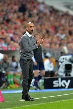 Munich head coach Pep Guardiola reacts during the soccer match between FC Bayern Munich and VfL Wolfsburg in the Allianz Arena in Munich, Germany, on Friday, Aug. 22, 2014. (AP Photo/Kerstin Joensson)