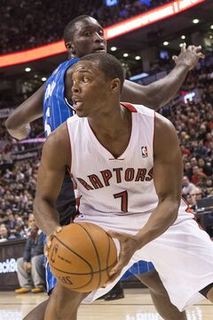 Toronto Raptors' Kyle Lowry (7) drives past Orlando Magic's Victor Oladipo during second half NBA basketball action in Toronto on Sunday, February 23, 2014. THE CANADIAN PRESS/Chris Young