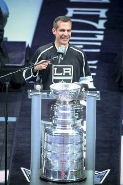 In this photo taken on Monday, June 16, 2014, Los Angeles Mayor Eric Garcetti talks to the crowd during the Los Angeles King's Stanley Cup hockey championship rally at Staples Center in Los Angelese. Mayor Garcetti used the F-bomb in declaring it a big day for LA, bringing 19,000 hockey fans to their feet, lighting up the Twitterverse in delight and, leaving some folks scratching their heads, wondering just what the heck the normally soft-spoken elected official was thinking. (AP Photo/Los Angeles Daily News, David Crane) NO SALES; MAGS OUT; HILLS OUT, LOS ANGELES TIMES OUT; VENTURA COUNTY STAR OUT ANTELOPE VALLEY PRESS OUT