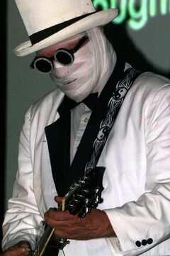 Nash the Slash always performed with his face wrapped in bandages and wore a tuxedo, top hat and sunglasses.