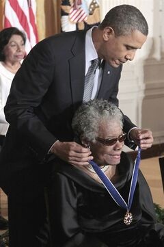 "FILE - This Feb. 15, 2011 file photo shows President Barack Obama kissing author and poet Maya Angelou after awarding her the 2010 Medal of Freedom during a ceremony in the East Room of the White House in Washington. President Barack Obama said Wednesday's passing of poet and author Maya Angelou has dimmed ""one of the brightest lights of our time."" Obama said in a statement that he and first lady Michelle Obama will always cherish the time they were privileged to spend with Angelou. He says Angelou had the ability to remind us that we are all God's children and that we all have something to offer. (AP Photo/Pablo Martinez Monsivais, File)"