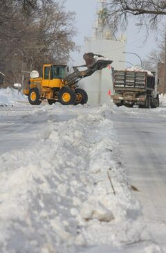 Snow removable crews work to clear 12th Street in the downtown area of Brandon in this file photo.