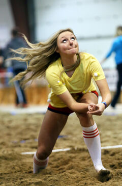 Janelle Forcand with team Orville Redenblockers prepares to dig the ball.