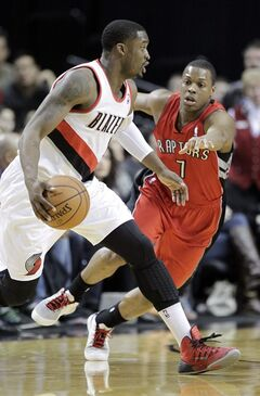 Portland Trail Blazers guard Wesley Matthews, left, drives on Toronto Raptors guard Kyle Lowry during the first half of an NBA basketball game in Portland, Ore., Saturday, Feb. 1, 2014. (AP Photo/Don Ryan)