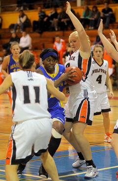 Brandon University's Nicisha Johnson tries to squeeze through Thompson Rivers Wolfpack defenders Saturday at the BU Gymansium. The Wolfpack beat the Bobcats 74-34.
