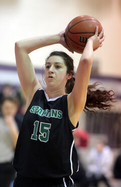 Neelin's Paige Thomson looks to pass in last night's game.