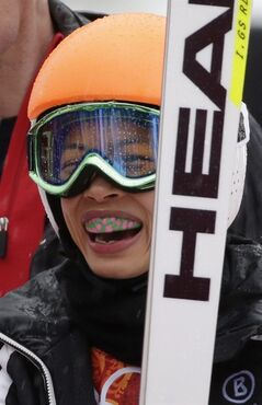 FILE - In this Tuesday, Feb. 18, 2014 file photo, violinst Vanessa Mae, starting under her father's name as Vanessa Vanakorn for Thailand, smiles after competing in the first run of the women's giant slalom at the Sochi 2014 Winter Olympics in Krasnaya Polyana, Russia. Slovenia said Friday, July 11, 2014 that it has suspended four of its ski officials for allegedly rigging the results of pop violinist Vanessa Mae to help her qualify for the Sochi Winter Olympics. (AP Photo/Gero Breloer, File)