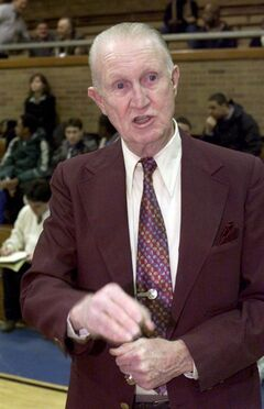 In this Jan. 18, 2000 photo, Archbishop Molloy basketball coach Jack Curran coaches his team during a timeout against Monsignor McClancey in Briarwood, N.Y. Curran, among the nation's winningest high school coaches in basketball and baseball, has died. He was 83. His death was confirmed Thursday, March 14, 2013 by Archbishop Molloy High School in Queens, where he coached for more than a half century. (AP Photo/Newsday, Kathy Kmonicek) NYC LOCALS OUT