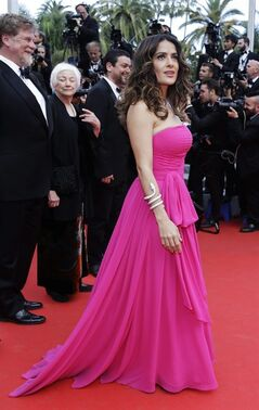 Actress Salma Hayek poses for photographers as she arrives for the screening of Saint-Laurent at the 67th international film festival, Cannes, southern France, Saturday, May 17, 2014. (AP Photo/Thibault Camus)
