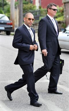 FILE - In this July 11, 2013 file photo, Nik Richie, left, owner of the gossip website TheDirty.com, leaves the Federal Courthouse in Covington, Ky., with his lawyer, David Gingra. An appeals court found Monday, June 16, 2014 that an Arizona-based gossip website should have been immune from being sued by Jones over online posts that she was promiscuous and had sexually transmitted diseases.The decision from the Cincinnati-based 6th U.S. Circuit Court of Appeals reverses a federal Kentucky judge's decision allowing the lawsuit to proceed. (AP Photo/Cincinnati Enquirer, Patrick Reddy) MANDATORY CREDIT; NO SALES